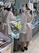shopping mall sales girls in a Tokyo sweets store