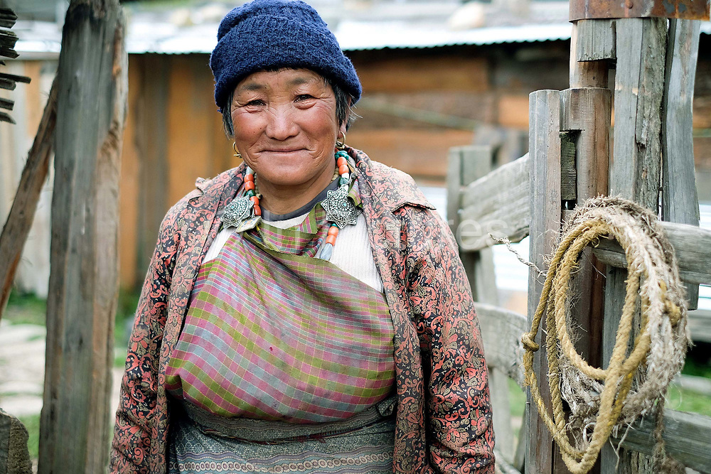 Portrait of Dorji Zam, a sheep farmer at her farm in Namephey village in the remote Phobjikha valley, Bhutan. With the easy availability of commercially processed wool and other alternatives for fabric for weaving, and the lack of human resources to look after the sheep, farming of sheep has gradually been in decline in Bhutan.