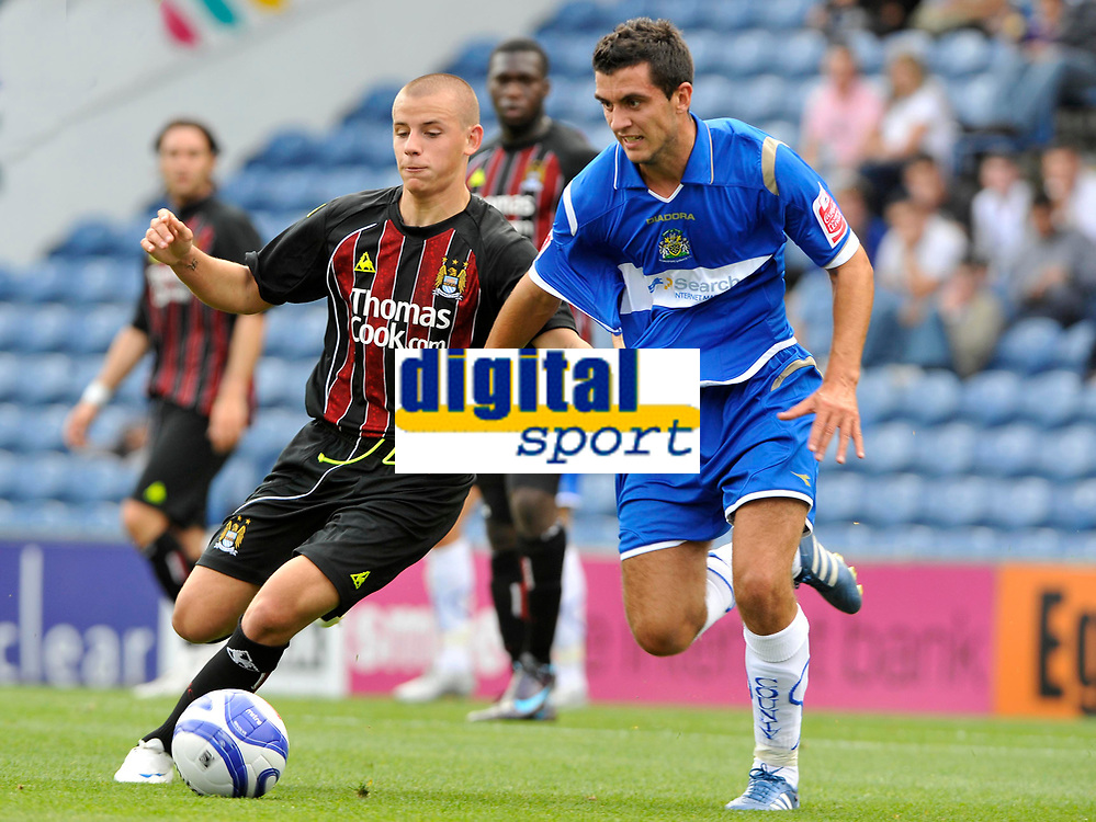 Manchester City's Vladimir Weiss (L) battles for the ball with Stockport County's Jimmy McNulty<br />Photo: Paul Greenwood/Richard Lane Photography. Stockport County v Manchester City. Pre Season Friendy. 02/08/2008.