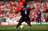 Photo: Daniel Hambury<br /> Barclaycard Premiership. Liverpool V Middlesborough   2/5/2004.  <br /> <br /> Liverpool's John Arne Riise and Middlesborough's Hugo Ehiogu