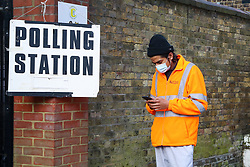 © Licensed to London News Pictures. 06/05/2021. London, UK. A voter wearing face covering queues outside a polling station in Haringey, North London to cast their vote in the London Mayoral Election. Polling stations have opened as Londoners vote for the next Mayor of London. Photo credit: Dinendra Haria/LNP