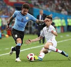 SOCHI, June 30, 2018  Raphael Guerreiro (R) of Portugal vies with Nahitan Nandez of Uruguay during the 2018 FIFA World Cup round of 16 match between Uruguay and Portugal in Sochi, Russia, June 30, 2018. (Credit Image: © Ye Pingfan/Xinhua via ZUMA Wire)