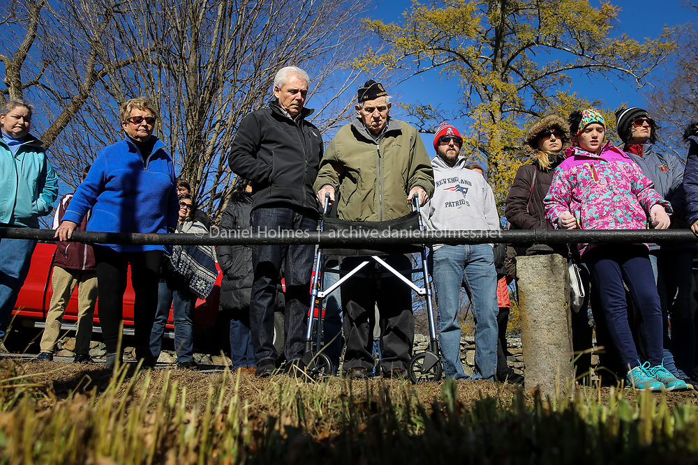 (11/11/18, SOUTHBOROUGH, MA) 98-year-old World War II veteran, John Bartolini, of Southborough, with assistance from his son Jack, attends the ceremony at the All Wars Memorial in Southborough during  Veterans Day on Sunday. [Daily News and Wicked Local Photo/Dan Holmes]