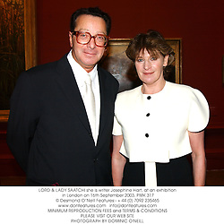 LORD & LADY SAATCHI she is writer Josephine Hart, at an exhibition in London on 16th September 2003.PMK 317