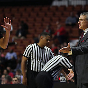 Frank Martin, South Carolina Head Coach, remonstrates with Laimonas Chatkevicius on the sideline during the St. John's vs South Carolina Men's College Basketball game in the Hall of Fame Shootout Tournament at Mohegan Sun Arena, Uncasville, Connecticut, USA. 22nd December 2015. Photo Tim Clayton