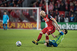 December 9, 2017 - Toronto, Ontario, Canada - Toronto FC midfielder MICHAEL BRADLEY (4) fights for the ball with Seattle Sounders midfielder NICOLAS LODEIRO (10) during the MLS Cup championship match at BMO Field in Toronto, Canada.  Toronto FC defeats Seattle Sounders 2 to 0. (Credit Image: © Mark Smith via ZUMA Wire)