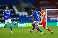 Millwall's Shaun Hutchinson (4) battles for possession with Cardiff City's Josh Murphy (11) during the EFL Sky Bet Championship match between Cardiff City and Millwall at the Cardiff City Stadium, Cardiff, Wales on 30 January 2021.