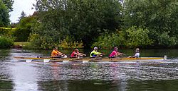 Rowers make their way along the River Thames at Weybridge, Surrey. Weybridge, Surrey, July 03 2019.