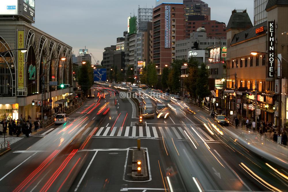 evening rush hour traffic near Shinagawa station Tokyo Japan