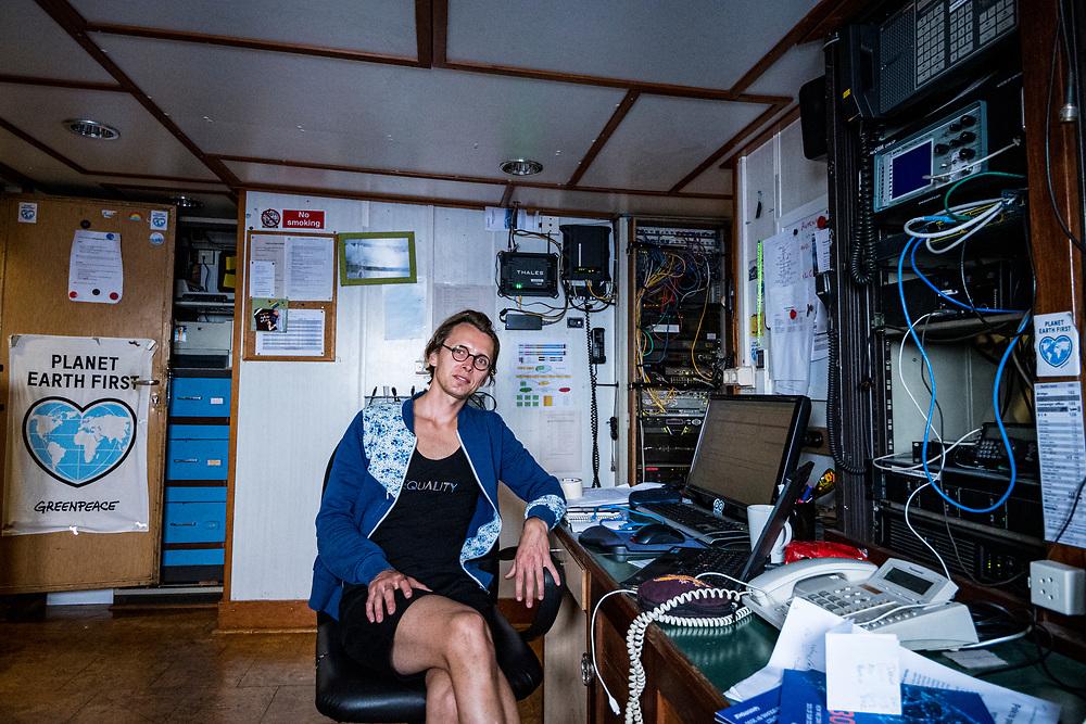 Radio Operator Till Seidensticker in his office aboard the Greenpeace ship Esperanza.