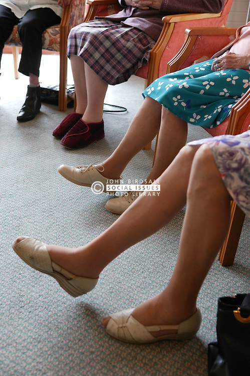 Group of elderly women taking part in a Music and Movement therapy class,