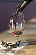 A tasting sample of wine is poured.<br /> Dean Rutz / The Seattle Times