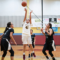 Kennedi Chapman (41) takes a shot for Rehoboth in their game against Tse' Yi' Gai Tuesday night.