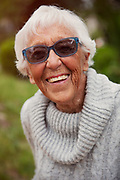 Senior Woman Smiling Outside Wearing Hip Sunglasses