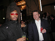 Darren de-Greads and Suggs. Smile1-D in association with Emporio Armani.  Wapping Power Station. 3 April 2001. © Copyright Photograph by Dafydd Jones 66 Stockwell Park Rd. London SW9 0DA Tel 020 7733 0108 www.dafjones.com