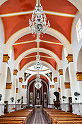 Interior view of the cathedral of Saint Joseph and Saint Andrew in San Andres Tuxtlas, Veracruz, Mexico. The church was built in 1870 features bell towers and a sober facade with Neoclassical influence