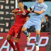 NEW YORK, NEW YORK - November 06: Jack Harrison #11 of New York City FC heads the ball while challenged by Justin Morrow #2 of Toronto FC during the NYCFC Vs Toronto FC MLS playoff game at Yankee Stadium on November 06, 2016 in New York City. (Photo by Tim Clayton/Corbis via Getty Images)