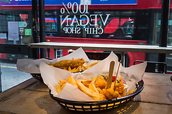 Plates of vegan 'scampi' and 'fish' and chips at London's first totally vegan chippy in Hackney, North East London. Hackney, London, October 08 2018.