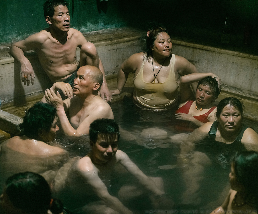 Men and women enjoying the hot spring. The Gasa hot springs known locally as Gasa  Tshachuu are known for their healing powers.