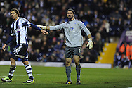 Crystal Palace goalkeeper Julian Speroni pats Diego Lugano of West Brom (l). FA Cup with Budweiser, 3rd round, West Bromwich Albion v Crystal Palace match at the Hawthorns in Birmingham, England on Saturday 4th Jan 2014.<br /> pic by Andrew Orchard, Andrew Orchard sports photography.