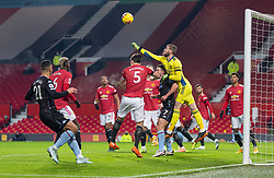 MANCHESTER, ENGLAND - Friday, January 1, 2020: Manchester United's goalkeeper David de Gea punches the ball away during the New Year's Day FA Premier League match between Manchester United FC and Aston Villa FC at Old Trafford. The game was played behind closed doors due to the UK government putting Greater Manchester in Tier 4: Stay at Home during the Coronavirus COVID-19 Pandemic. (Pic by David Rawcliffe/Propaganda)