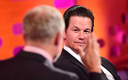 Host Graham Norton (left) and Mark Wahlberg during filming of the Graham Norton Show at the London Studios, to be aired on BBC One on Friday evening.