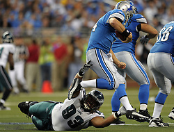 DETROIT - SEPTEMBER 19: Defensive tackle Trevor Laws #93 of the Philadelphia Eagles tries to sack quarterback Shaun Hill #14 of the Detroit Lions on September 19, 2010 at Ford Field in Detroit, Michigan. The Eagles won 35-32. (Photo by Drew Hallowell/Getty Images)  *** Local Caption *** Trevor Laws;Shaun Hill