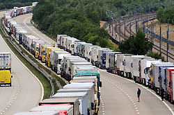 © Licensed to London News Pictures. 28/07/2015<br /> <br /> <br /> Operation stack lorries between J8 and J9 for Ashford on the M20. <br /> Operation stack is back on the M20 in Kent.<br /> Just days after Operation Stack was taken off the M20, it was brought back in the early hours of this morning.<br /> The authorities are blaming a heavy volume of traffic heading towards the Port of Dover and Eurotunnel and the continued disruption in Calais.<br /> The coast-bound carriageway between junctions 8 and 9 is closed to allow lorries to park, but the slip roads at junctions 9, 10 and 12 and 13 have also been shut. <br /> <br /> (Byline:Grant Falvey/LNP)