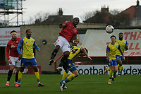 Football - 2020 / 2021 Emirates FA Cup - Second Round: Morecambe vs. Solihull Moors<br /> <br /> Adam Phillips of Morecambe climbs over Mitch Hancox of Solihull Moors to put in a header, at the Mazuma Stadium.<br /> <br /> COLORSPORT/ALAN MARTIN