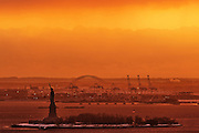 Statue of Liberty and New Jersey Port at Sunset, New-York City, NYC, USA
