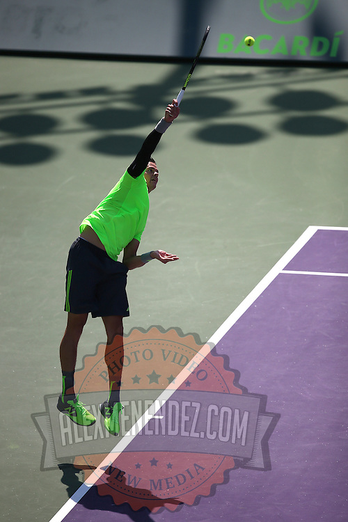 Milos Raonic of Canada serves the ball to Jeremy Chardy of France during their match at the Miami Open tennis tournament at Crandon Park on Monday, March 30, 2015 in Key Biscayne, Florida. (AP Photo/Alex Menendez)