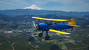 Stearman Model 70, prototype of the famous PT-13, PT-17 series, flying over the Hood River Valley.
