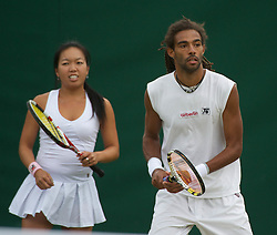24.06.2011, Wimbledon, London, GBR, Wimbledon Tennis Championships, im Bild Dustin Brown (GER) and Vania King (USA) in action during the Mixed Doubles 1st Round match on day five of the Wimbledon Lawn Tennis Championships at the All England Lawn Tennis and Croquet Club, EXPA Pictures © 2011, PhotoCredit: EXPA/ Propaganda/ *** ATTENTION *** UK OUT!