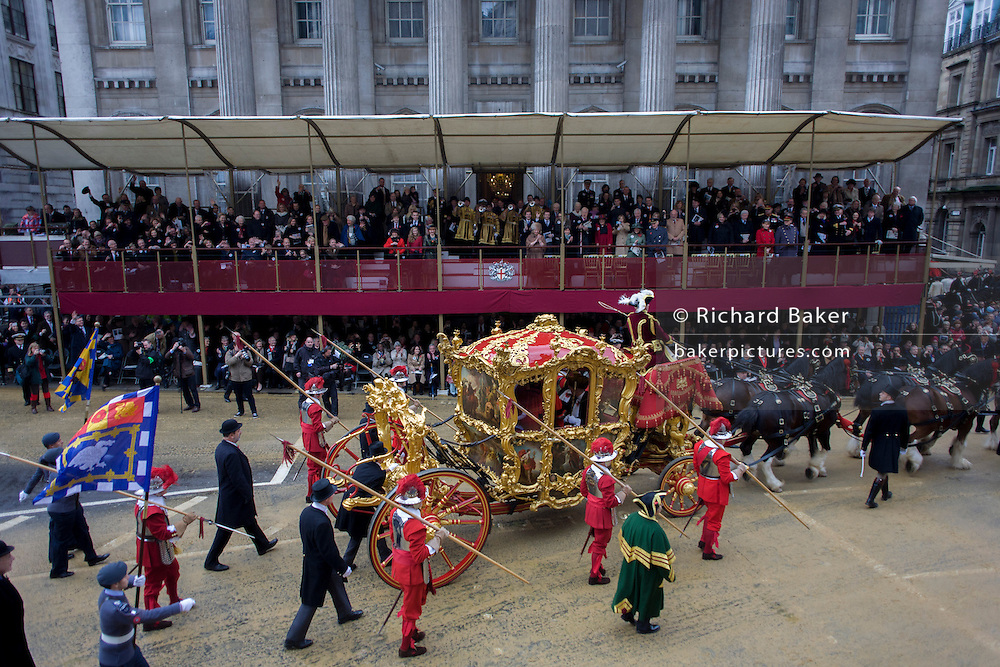 The Lord Mayor's carriage arrives at Mansion House during the Lord Mayor's Show in the City of London. Alderman and Rt Hon The Lord Mayor of London, Roger Gifford, a merchant banker with Swedish bank SEB is the 685th in the City of London's ancient history. The new Mayor's procession consists of a 3-mile, 150-float parade of commercial and military organisations going back to medieval times. This is the oldest and longest civic procession in the world that has survived the Plague and the Blitz, today one of the best-loved pageants. Henry Fitz-Ailwyn was the first Lord Mayor (1189-1212) and ever since, eminent city fathers (and one woman) have taken the role of the sovereign's representative in the City - London's ancient, self-governing financial district. The role ensured the King had an ally within the prosperous enclave. .