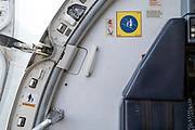 door hinge opeing of a passenger airplane with steward seat