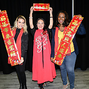 Diana Arama, Connie Zhang and Medina Williamson attend the 2020 China-Britain Chinese New Year Extravaganza with 200 performers from over 20 art groups from both China and the UK showcase at Logan Hall on 18th January 2020, London, UK.