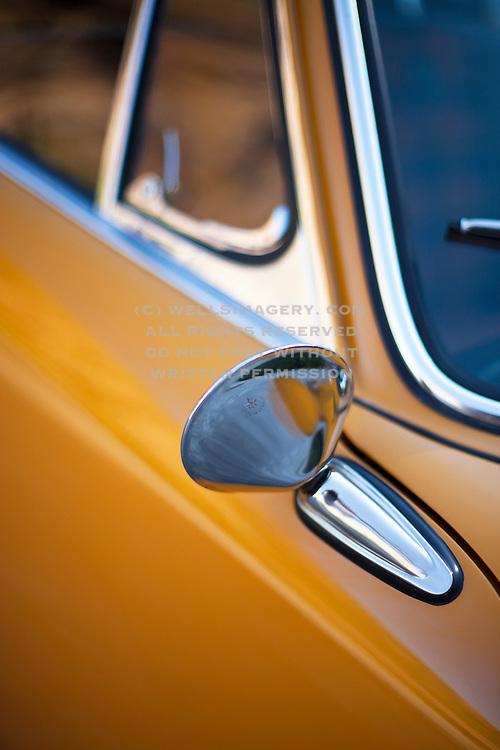Image of a 1967 Bahama Yellow Porsche 912 in Salt Lake City, Utah, American Southwest by Randy Wells