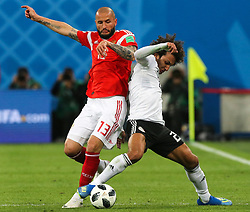 June 19, 2018 - Saint Petersburg, Russia - Fedor Kudriashov (L) of the Russia national football team and Amr Warda of the Egypt national football team vie for the ball during the 2018 FIFA World Cup match, first stage - Group A between Russia and Egypt at Saint Petersburg Stadium on June 19, 2018 in St. Petersburg, Russia. (Credit Image: © Igor Russak/NurPhoto via ZUMA Press)