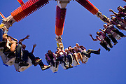 """Oct 14, 2008 -- PHOENIX, AZ: People ride the """"G Force"""" thrill ride at the Arizona State Fair Tuesday. The Arizona State Fair started Oct.  10 and runs through Nov. 2. Carnival and midway workers who have worked the fair for years say attendance so far is much lower than in the past and people at the fair this year aren't spending as much money as they have in the past. Photo by Jack Kurtz / ZUMA Press"""