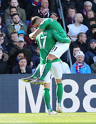 Brighton & Hove Albion's Glenn Murray (left) celebrates scoring his side's first goal of the game