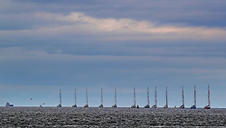 12 Clipper boats sail past the wind farm at the Mersey Bar before they sail into Liverpool ahead of this Sunday's start of the Clipper Round the World yacht race.