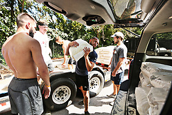 From left, Jacob Carter, Shawn Hanrahan, Isaac McCullough, Christopher Arenas and David Hewitt, all members at 12th State Crossfit in Raleigh, NC, USA, help sandbag the building in preparation for Hurricane Florence on Wednesday, September 12, 2018. The gym, which was hit hard by flooding caused by Hurricane Matthew, asked members to help them move gym equipment and prepare for the storm. Photo by Juli Leonard/Raleigh News & Observer/TNS/ABACAPRESS.COM