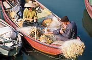 01 DECEMBER 1988  - HONG KONG: Fisherfolk mend their nets on Hong Kong.  PHOTO © JACK KURTZ  traditional  family  lifestyle  poverty  fishing  water  food