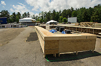 Crews begin construction on the bar areas and VIP Stage at the Weirs Beach Drive In with the main stage to be constructed towards the upper part of the lot later this week as set up begins for Laconia Fest on Tuesday for Motorcycle Week 2016.  (Karen Bobotas/for the Laconia Daily Sun)