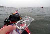 Kayaker using compass in foggy weather outside Jomfruland, Telemark - kajakkpadler navigerer etter kompass i tåke. Jomfruland, Telemark