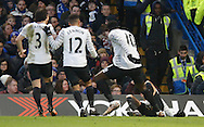 Everton midfielder Kevin Mirallas is joined by his teammates to celebrate his goal during the Barclays Premier League match between Chelsea and Everton at Stamford Bridge, London, England on 16 January 2016. Photo by Andy Walter.