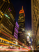 The Empire State Building lit up in Red color, New York City