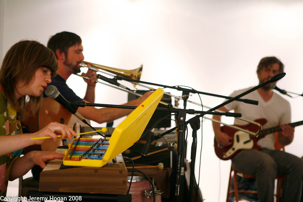 Ashley Eriksson, John Ringhofer and Eli Moore perform as Half-Handed Cloud during a show at the Art Hospital in Bloomington, Indiana.