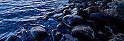 Rocks along the shore of Laguna Capri, Patagonia, Argentina