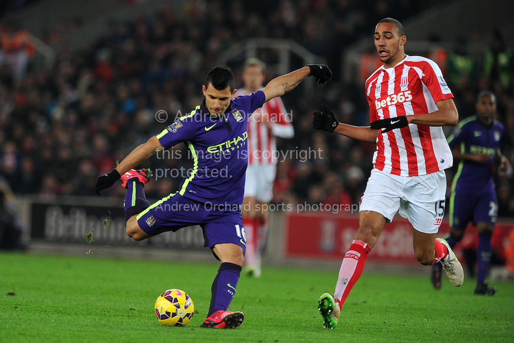 Sergio Aguero of Manchester city lines up a shot at goal. Barclays Premier League match, Stoke city v Manchester city at the Britannia Stadium in Stoke on Trent , Staffs on Wed 11th Feb 2015.<br /> pic by Andrew Orchard, Andrew Orchard sports photography.